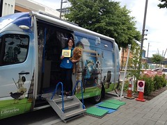 Katie and the library van at Margaret Mahy Family Playground