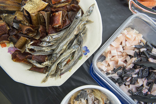 Traditional Alaska Native foods from around the state, including salmon, candlefish, and bowhead whale muktuk are pictured at the monthly Native Foods Potluck hosted at the Dena'ina Wellness Center.