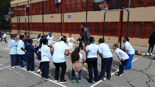 WITS Coach Rob Sanders leading students in a fun and interactive game on the recess yard