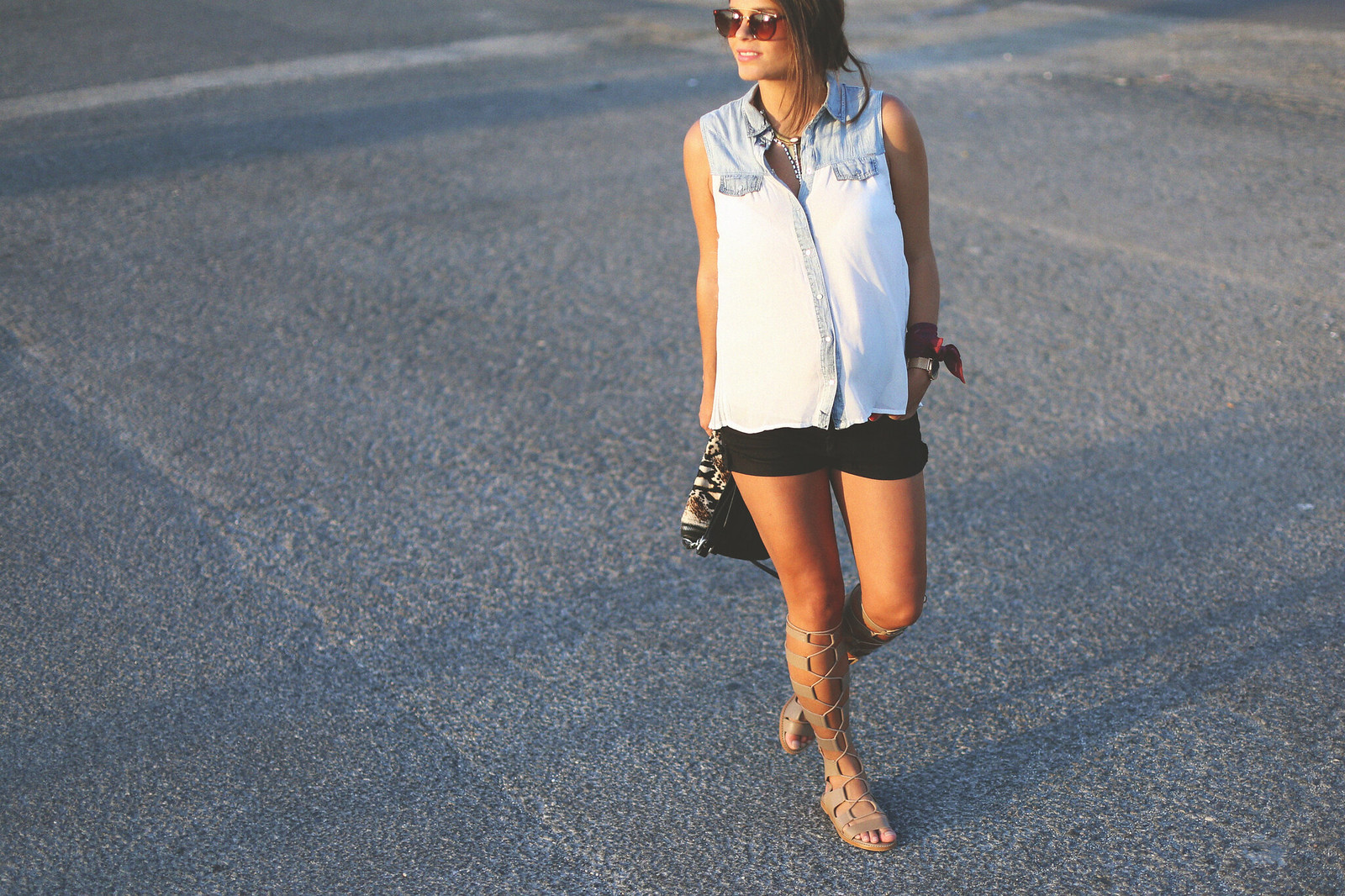 5. white denim vest black shorts sandals