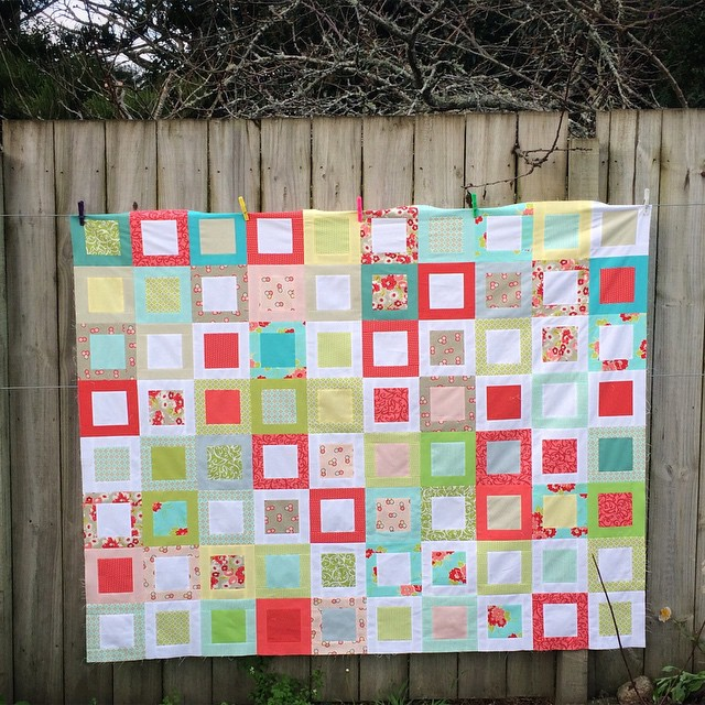 Lap quilt using the Sweet Daisy pattern by @redpepperquilts and various Bonnie and Camille fabrics mixed with solids. Fun and fast! #quilt #patchwork