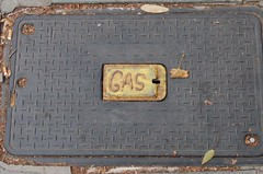 wood(0.0), trunk(0.0), antique(0.0), brick(0.0), manhole(1.0), manhole cover(1.0),