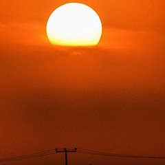 The #sunset makes the #sun #appear #like a #huge #ball of #fire in #Manama #Bahrain #evening #sky #colour