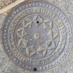 ancient history(0.0), stone carving(0.0), dome(0.0), symmetry(1.0), manhole(1.0), manhole cover(1.0), circle(1.0),
