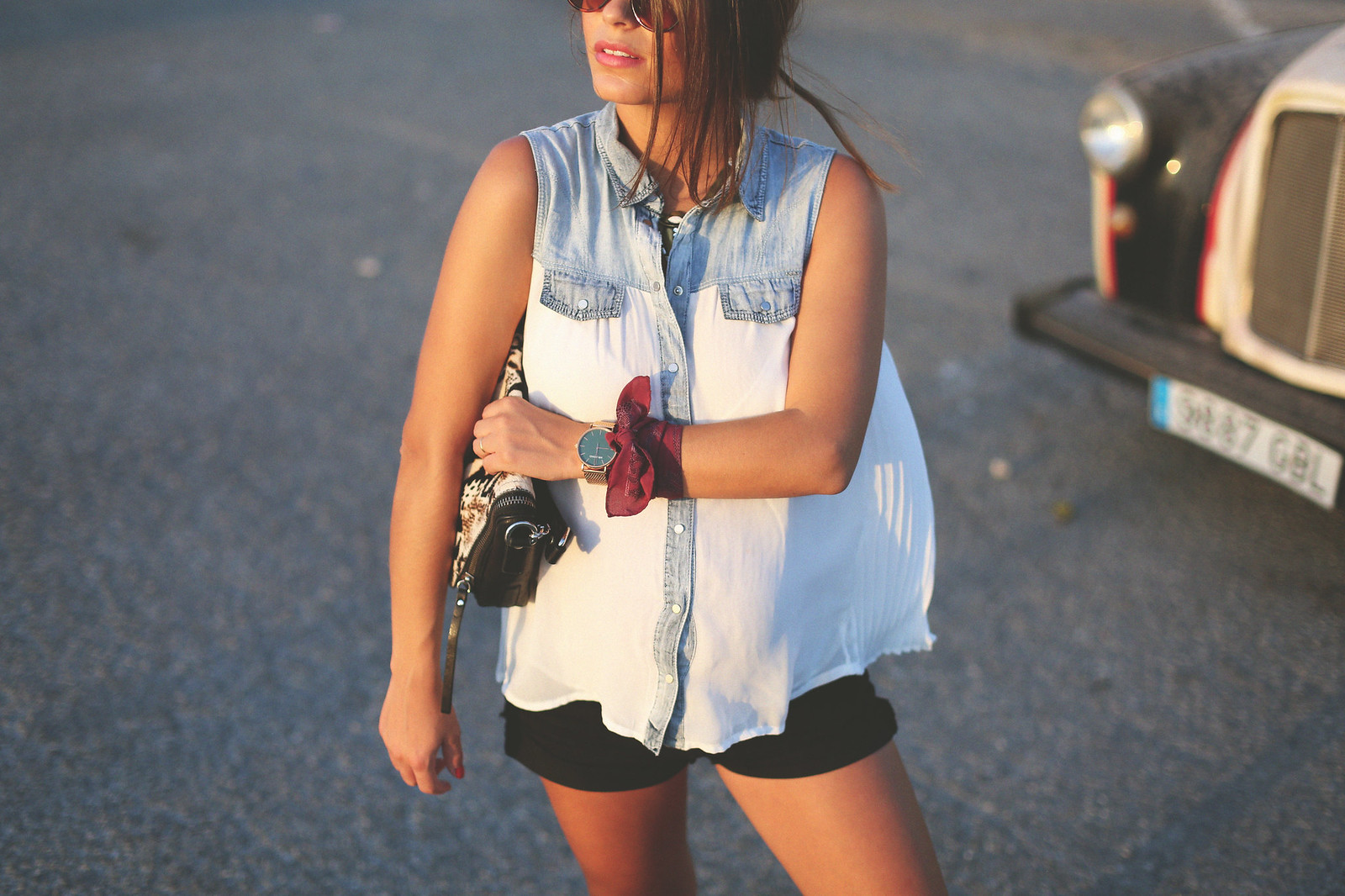 8. white denim vest black shorts sandals