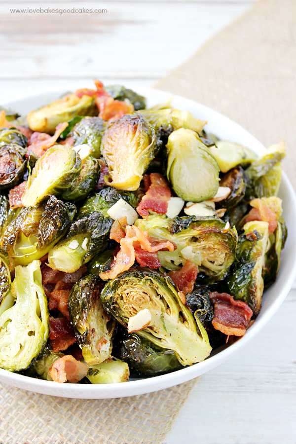 Roasted Brussels Sprouts with Bacon & Almonds close up from the side.