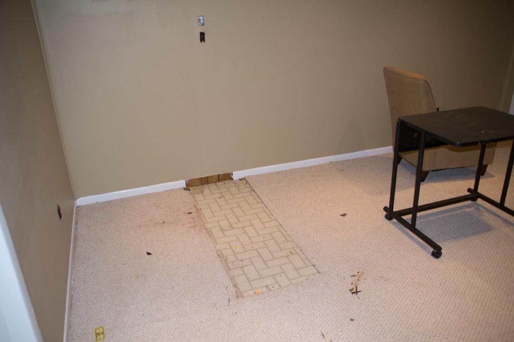 Old linoleum under the carpet