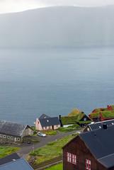 Rain in Velbastaður. View over to the island Hestur, Faroe Islands