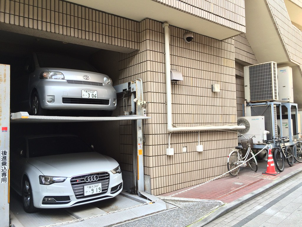 vertical private parking (the less used car goes on top)