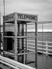 Telephone Booth On A Pier - B&W Version; Long Island, New York