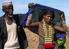 Issa tribe husband with his wife, Afar region, Yangudi Rassa National Park, Ethiopia