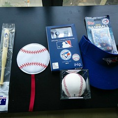 July 20, 2015 - 12:16 - Contents of the Mystery Bag: mini bat pen, luggage tag, MLB ear buds, baseball cards, visor, and a baseball signed by Devon White. Not bad! Maybe I can get the cards signed by the team. #bluejays #toronto #mlb #jayscare #mysterybag #mysterybox #swag