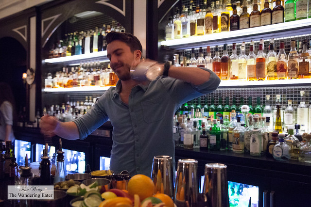 Ben, our bartender shaking a drink