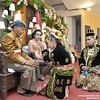 Sungkeman ceremony. Indonesian Javanese wedding photo. Mita & Radit wedding at Yogyakarta. Wedding photos by @Poetrafoto, visit: http://wedding.poetrafoto.com :thumbsup::blush::heart_eyes: