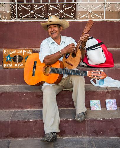 cuba trinidad guitar hat steps musician cds street performer