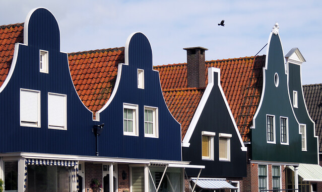 The traditional rooflines of Dutch houses translate just as well in wood as in the more typical brick (Edam, Holland)