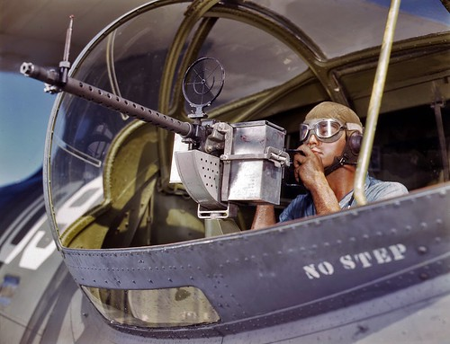 Jesse Rhodes Waller with his M1919 Browning machine gun in a Catalina at the naval air station in Corpus Christi, Texas. 1942.