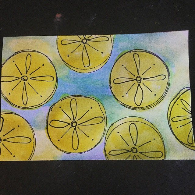 Day eight for #icad2015 Getting a bit more adventurous.  I made some messy circles by tracing a cap, added some doodling, #watercolor background and added some yellow watercolor to my circles.  What do they look like to you?