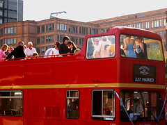 A Just Married red London bus with open top deck