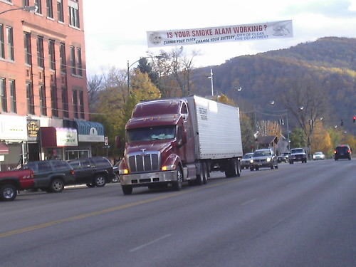 OLEAN MISTAKE ON A BANNER ABOVE THE TRUCK. SEE THE MISTAKE?