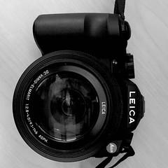 teleconverter(0.0), cameras & optics(1.0), digital camera(1.0), camera(1.0), shutter(1.0), mirrorless interchangeable-lens camera(1.0), lens(1.0), digital slr(1.0), monochrome photography(1.0), monochrome(1.0), black-and-white(1.0), camera lens(1.0), reflex camera(1.0),