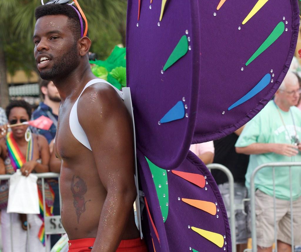 black man with purple wings