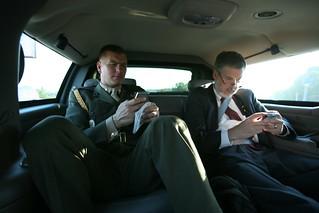 David Addington and Military Aide Tim Stefanick Type on Their BlackBerries While in Limousine in Kiev, Ukraine