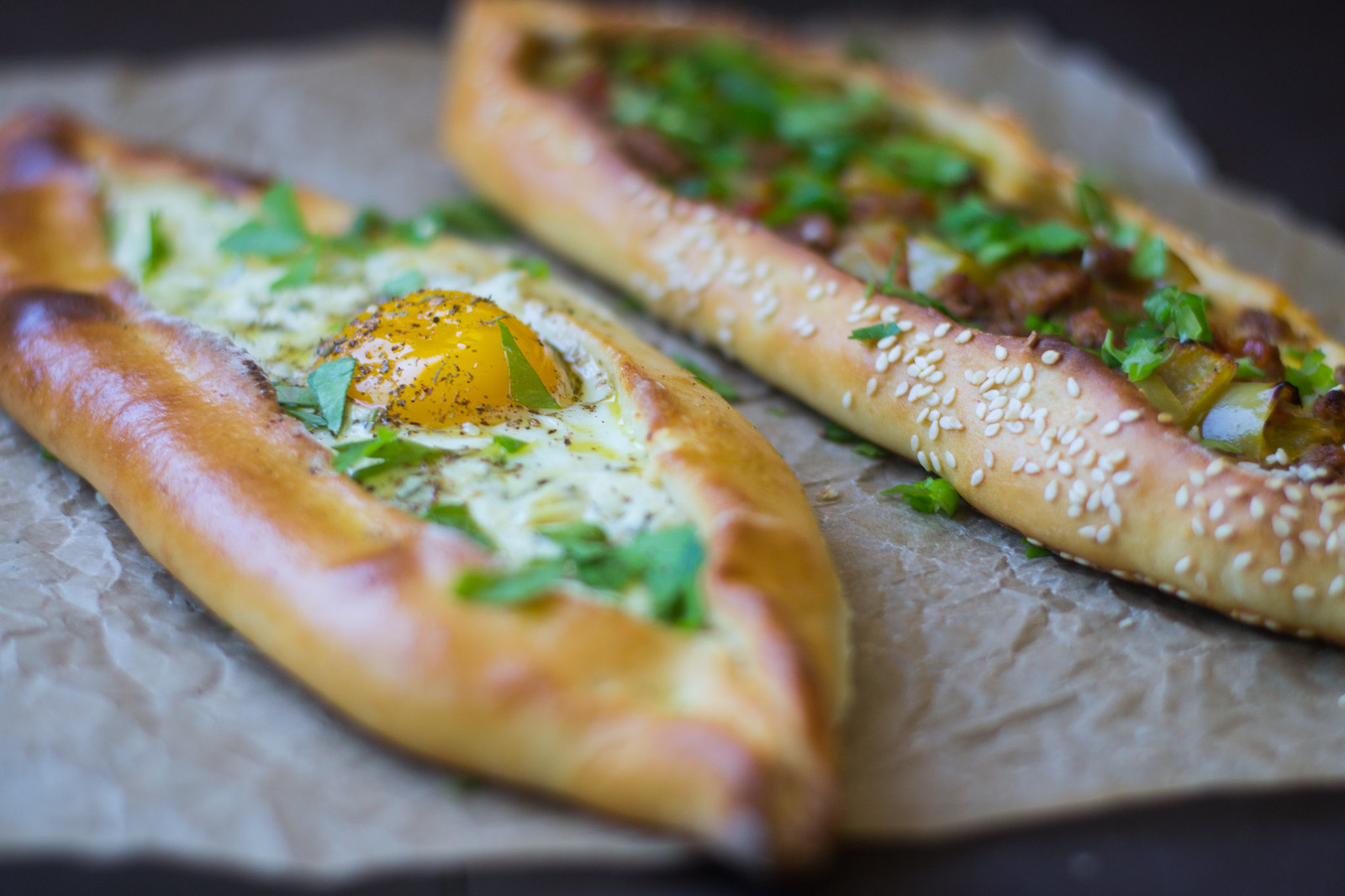 Turkish Pide (aka pizza) is a Turkish comfort food favorite! Here are 2 different fillings, one with meat and peppers and the other with cheese and egg.