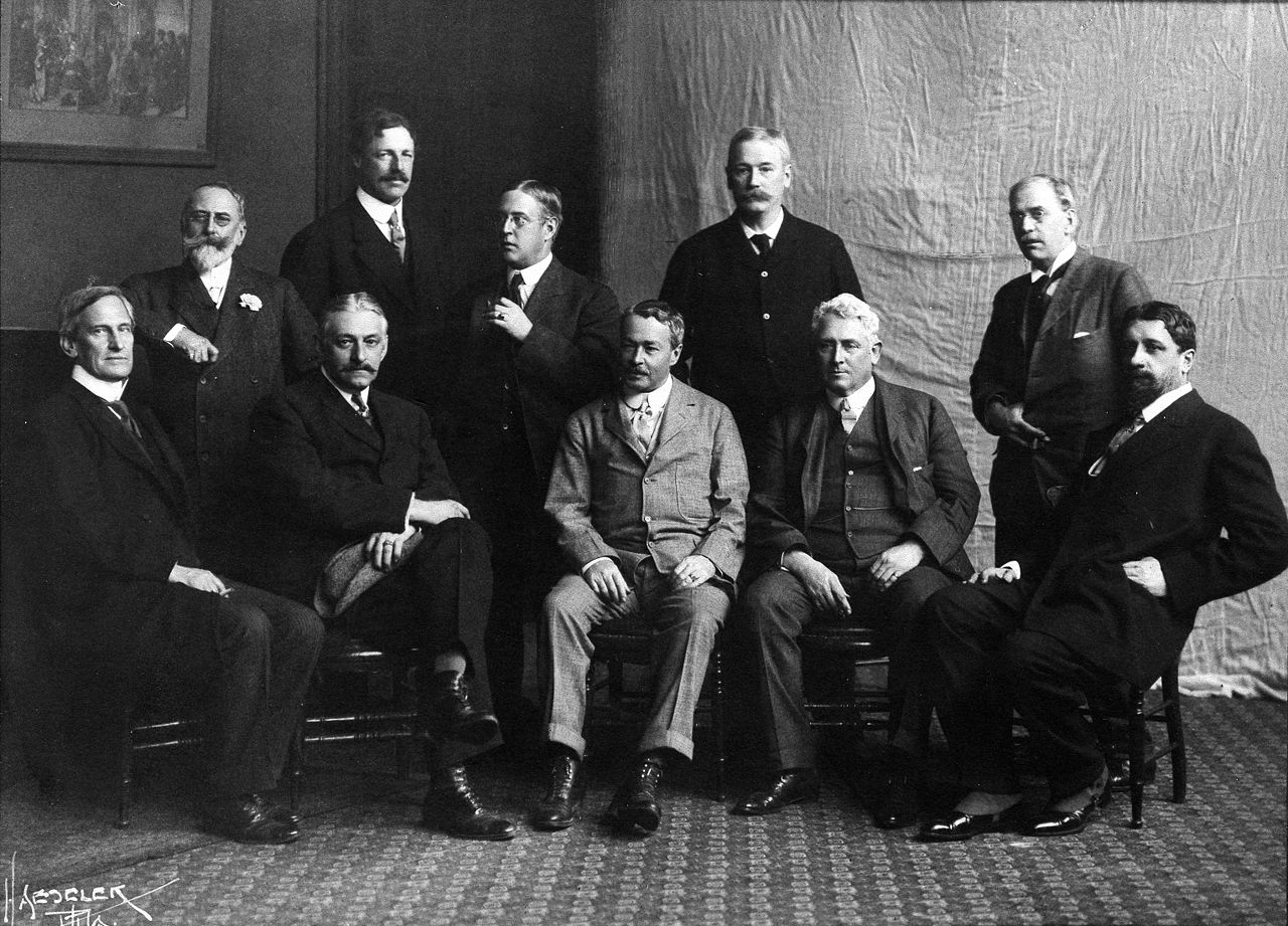 Seated, left to right: Edward Simmons, Willard L. Metcalf, Childe Hassam, J. Alden Weir, Robert Reid Standing, left to right: William Merritt Chase, Frank W. Benson, Edmund C. Tarbell, Thomas Wilmer Dewing, Joseph DeCamp