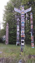 trail(0.0), outdoor structure(0.0), totem pole(1.0), art(1.0), tree(1.0), sculpture(1.0), totem(1.0),