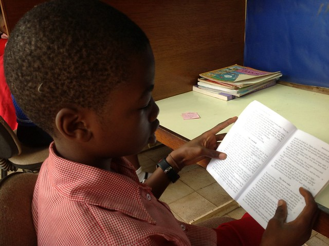 Young boy reading in Bamenda