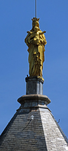 The golden statue on the steeple of the chapel at Cap Fagnet on the Normandy Coast of France