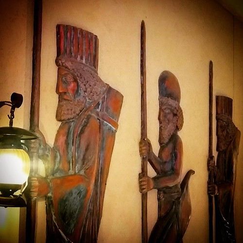 Figure reliefs outside of Arya Persian Restaurant