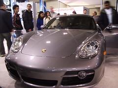 wheel(0.0), convertible(0.0), automobile(1.0), automotive exterior(1.0), vehicle(1.0), automotive design(1.0), porsche(1.0), porsche cayman(1.0), auto show(1.0), land vehicle(1.0), luxury vehicle(1.0), supercar(1.0),