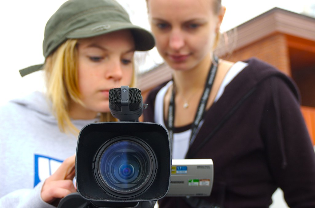 Girls holding camera