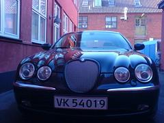 automobile(1.0), automotive exterior(1.0), vehicle(1.0), performance car(1.0), automotive design(1.0), mid-size car(1.0), jaguar s-type(1.0), land vehicle(1.0), luxury vehicle(1.0), jaguar s-type(1.0),