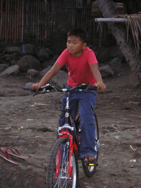 Photo:Happy with his brand new bike By Lola Josefina