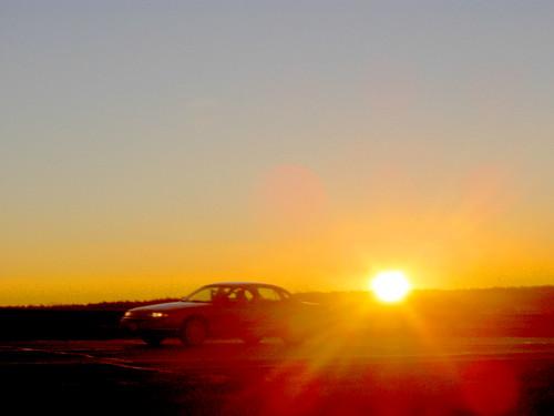 sunrise morning car driving solarflare sky dramatic vibrant sun samoff