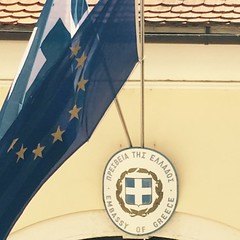The view from our current kitchen window. Wondering will these two flags (Greece and EU) still hang side by side in two days? The embassy seems very quiet. Guess they're busy or something.
