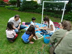 Jessi helping the kids with their individual weaving