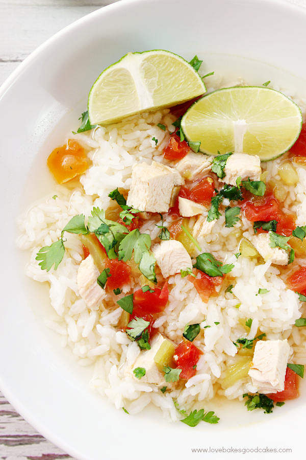 Simple Southwest Chicken & Rice Soup in a white bowl with a sliced lime.