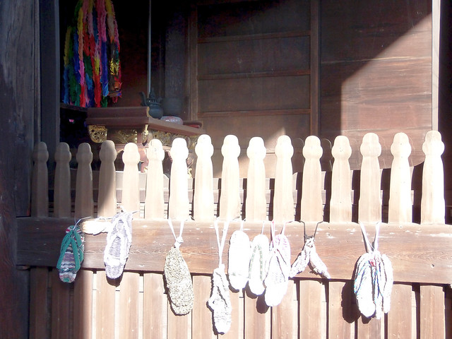 Photo:#1230 sandal offerings hanging from gate By Nemo's great uncle
