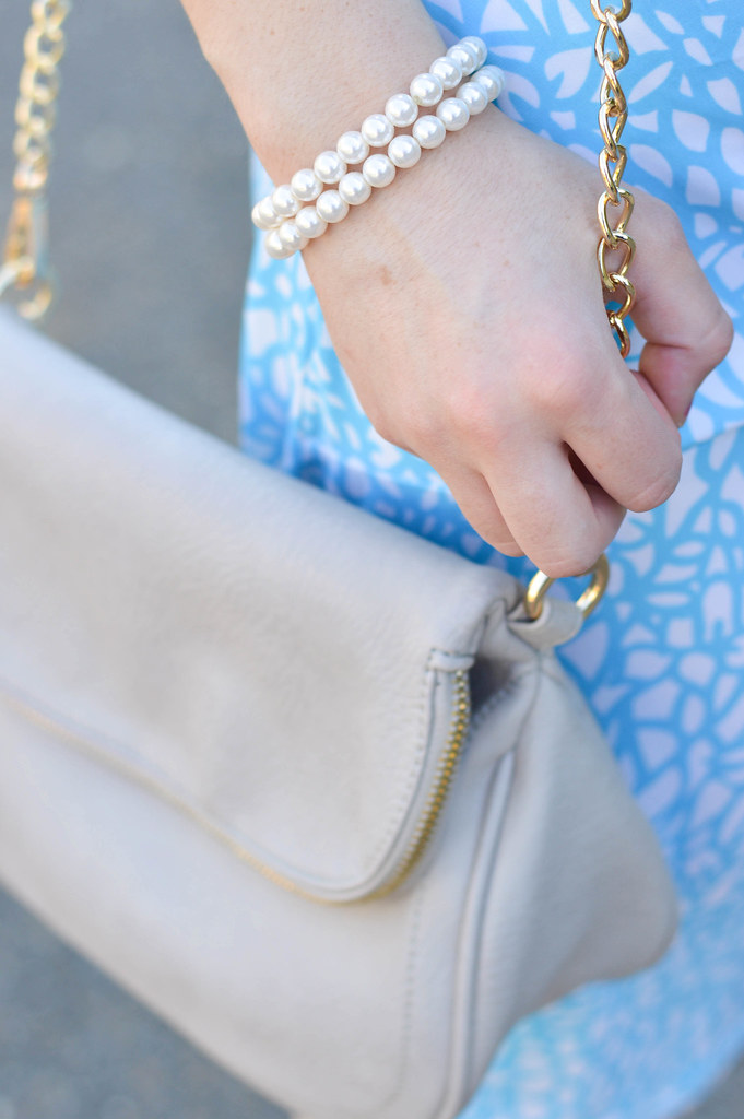 pearls and grey bag