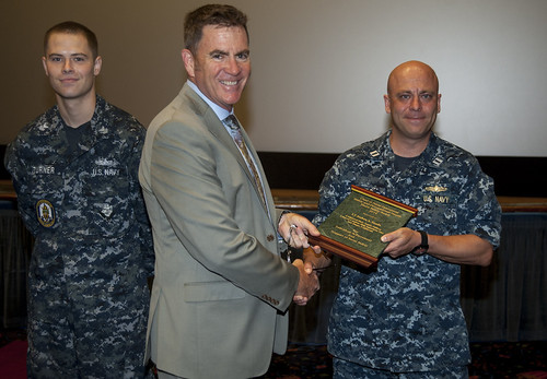SAN DIEGO - Kevin Couch, Director of Operational Safety, presents Lt. Josh Sando and Operations Specialist 1st Class Christian Turner, with a plaque.