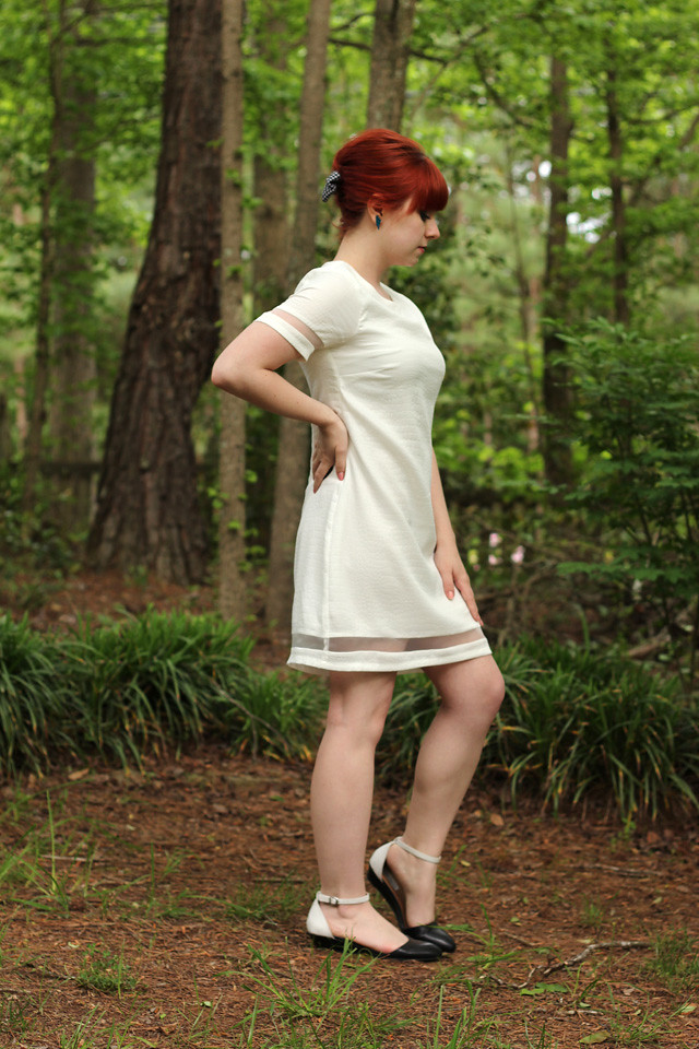 White Shift Dress with Sheer Cutout Hem, Red Bouffant, and Two-toned Flats