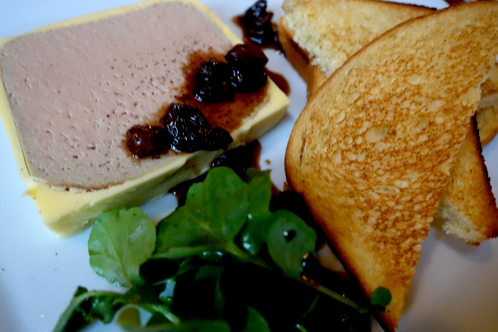 Russell's Restaurant - Chicken Liver Parfait A smooth Pâté served on Toasted Brioche finished with a Sultana and Sauternes Jus