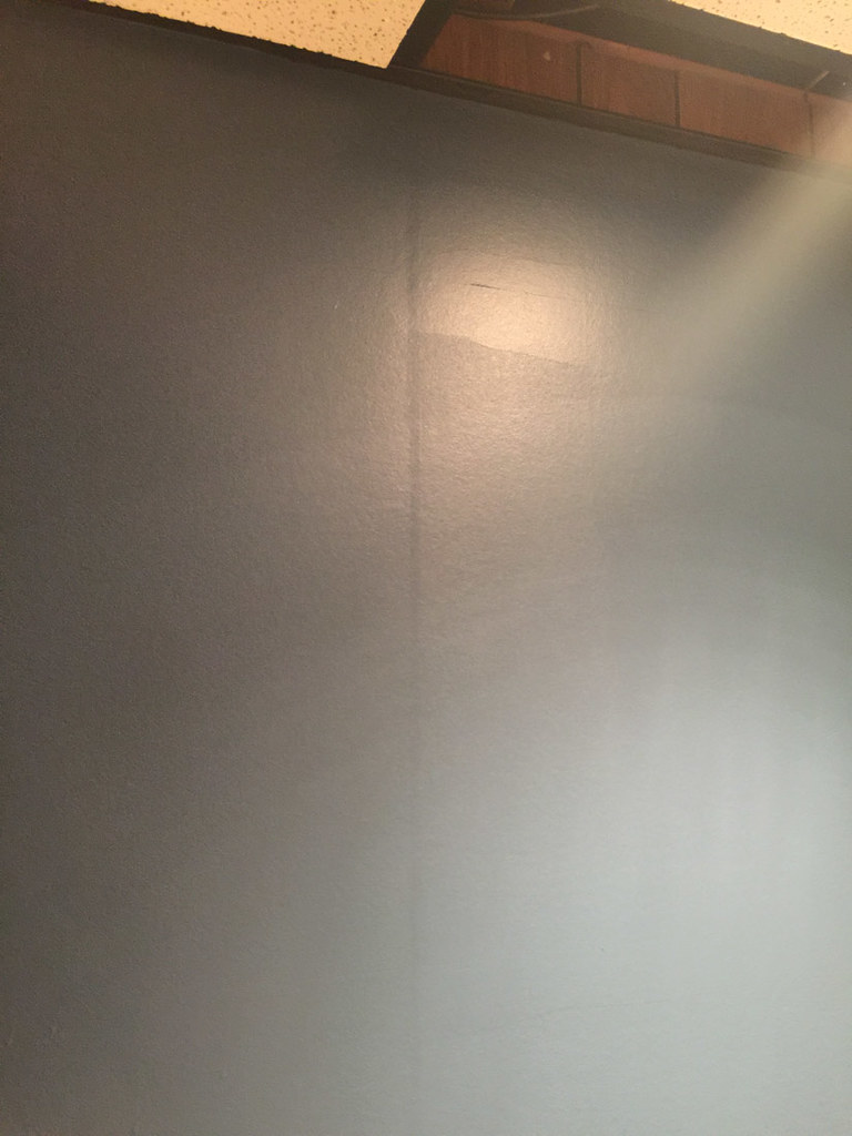 Visible groove in wood paneling under wallpaper