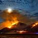 Fire under a Full Moon by Dave Toussaint (www.photographersnature.com)