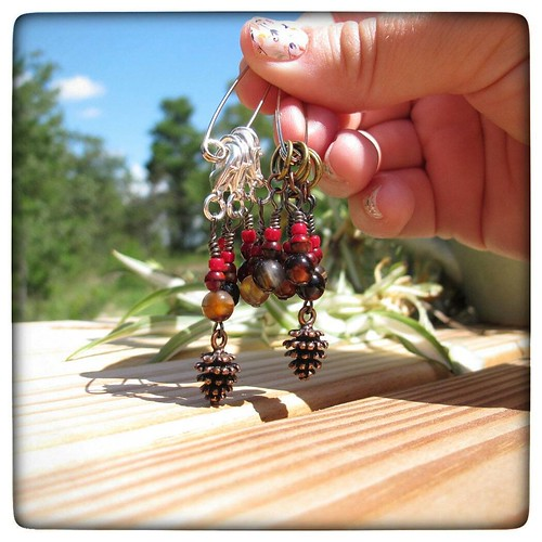 New in the shop - red pine cone stitch markers! Available in rings that fit up to a US 8 (5mm) or in lobster clasps. I feel like I'm forgetting to tell you something vital about them. Link in the comments!  #stitchmarkers