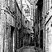 Périgueux: a street in the old part of town 2(b&w) by mistca